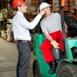 Stock Photo: Supervisor Instructing Forklift Driver