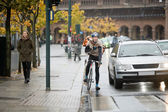 Male Cyclist Using Walkie-Talkie On Street — Stock Photo