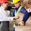 Supervisor And Foreman Checking Cardboard At Warehouse — Stock Photo