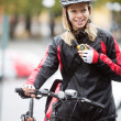 Female Cyclist With Courier Bag Using Walkie-Talkie — Stockfoto