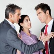 Businesswoman Acting As Peacemaker Between Colleagues - Stockfoto