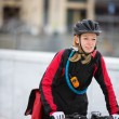 Young Woman Riding Bicycle With Courier Delivery Bag - Foto Stock