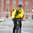 Male Cyclist With Courier Bag Using Walkie-Talkie - Foto Stock