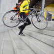 Courier Delivery Man With Bicycle And Backpack Walking Up Steps — Stock Photo