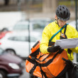 Stock Photo: Male Cyclist With Package And Courier Bag On Street