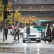 Vehicles Waiting For Commuters To Cross The Street - ストック写真