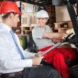 Forklift Driver Communicating With Supervisor — Stock Photo