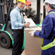 Foto Stock: Supervisor Showing Clipboard To Foreman