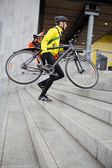 Courier Delivery Man With Bicycle And Backpack Walking Up Steps — Stok fotoğraf