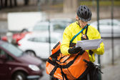 Male Cyclist With Package And Courier Bag On Street — Stok fotoğraf