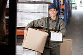 Male Supervisor With Clipboard And Cardboard Box — Stock Photo