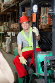 Foreman Sitting In Forklift At Warehouse — Stock Photo