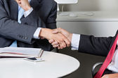 Midsection Of Businessmen Shaking Hands — Stock Photo