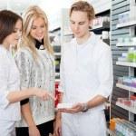 Pharmacist Assisting Female Shopper — Stock Photo