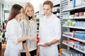 Pharmacist Assisting Female Shopper — Stock Photo