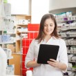 Pharmacist Helping Customer with Digital Tablet — Stock Photo