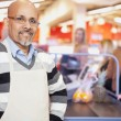 Grocery Store Cashier Standing At Checkout Counter — Stock Photo #15855405