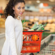 Stock Photo: WomWith Shopping Basket Standing At Checkout Counter In Super