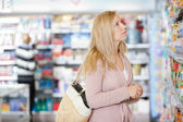 Young Woman Shopping At Supermarket — Stock Photo