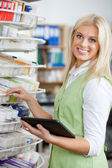 Young Blond Pharmacist Using Digital Tablet — Stock Photo