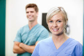 Young Female Vet In Scrubs Smiling — Stock Photo