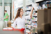 Pharmacist Stocking Shelves — Stock Photo