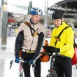 Courier Delivery Men With Bicycles Using Digital Tablet — Stock Photo