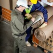 Stock Photo: Foreman With Supervisor Writing Notes At Warehouse