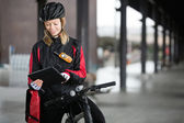 Female Cyclist With Courier Bag Using Digital Tablet — Stok fotoğraf