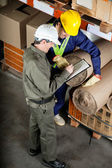 Foreman With Supervisor Writing Notes At Warehouse — Stock Photo