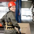 Warehouse Worker Pushing Handtruck With Cardboard Boxes — Stock Photo