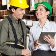 Supervisor With Digital Tablet And Foreman At Warehouse — Stock Photo