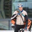 Young Courier Delivery Man With Bicycle Using Walkie-Talkie - Foto de Stock  