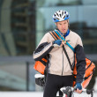 Young Courier Delivery Man With Bicycle Using Walkie-Talkie - Foto Stock