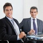 Businessmen Using Digital Tablet In Office — Stock Photo #16342999