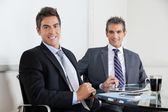 Businessmen Using Digital Tablet In Office — Stock Photo