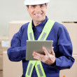 Foreman Using Digital Tablet At Warehouse - Foto Stock