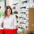 Pharmacist Stocking Shelves in Pharmacy — Stock Photo
