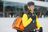 Male Cyclist With Courier Delivery Bag Using Walkie-Talkie — Stock Photo