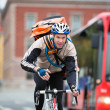 Male Cyclist With Courier Delivery Bag Riding Bicycle - Stock Photo