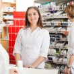 Female Pharmacist Helping Customer — Stock Photo