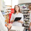 Pharmacist with Digital Tablet — Stock Photo #16507591