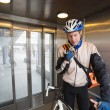 Male Cyclist With Courier Bag In An Elevator - Stock Photo