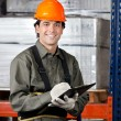 Young Male Supervisor With Clipboard Smiling — Stock Photo #16509773