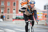 Male Cyclist With Courier Delivery Bag Riding Bicycle — Stock Photo