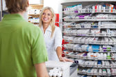 Helpful Pharmacist Employee — Stock Photo