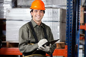 Young Male Supervisor With Clipboard Smiling — Stock Photo
