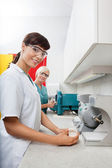 Dentist Holding Dental Plaster Mold With Assistant At Clinic — Stock Photo