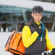 Cyclist With Courier Delivery Bag Using Walkie- Talkie — Stock Photo