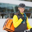 Cyclist With Courier Delivery Bag Using Walkie- Talkie — Stock Photo #16631667